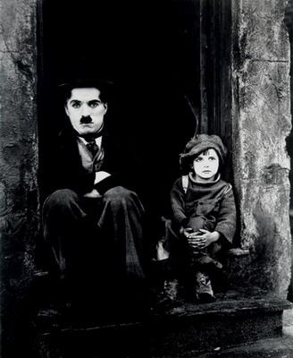 Charlie Chaplin & Jackie Coogan in The Kid, 1925